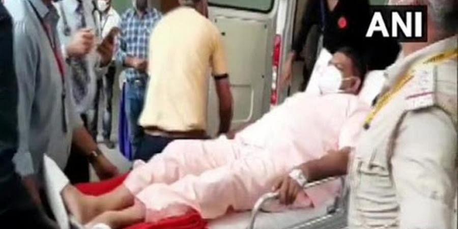 Matar MLA Kesarisinh Jesangbhai Solanki arrives in in an ambulance to cast his vote in Gandhinagar.