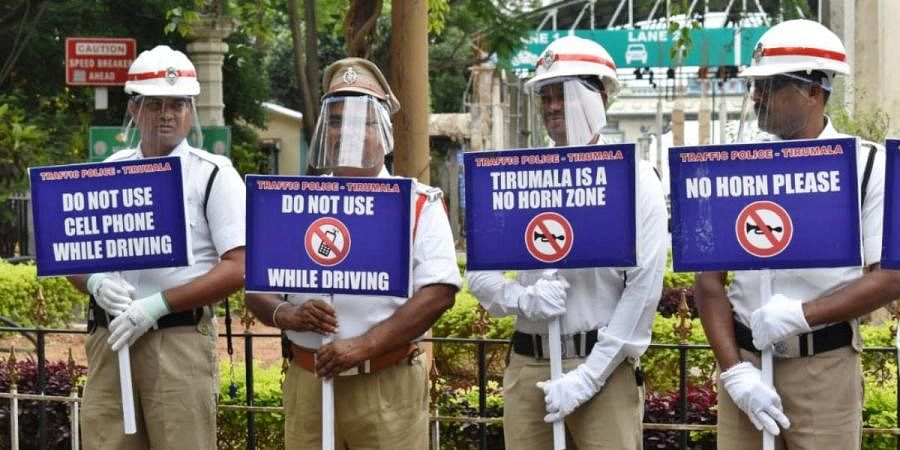 Traffic police hold placards as part of anti-noise awareness campaign at Tirumala on Thursday