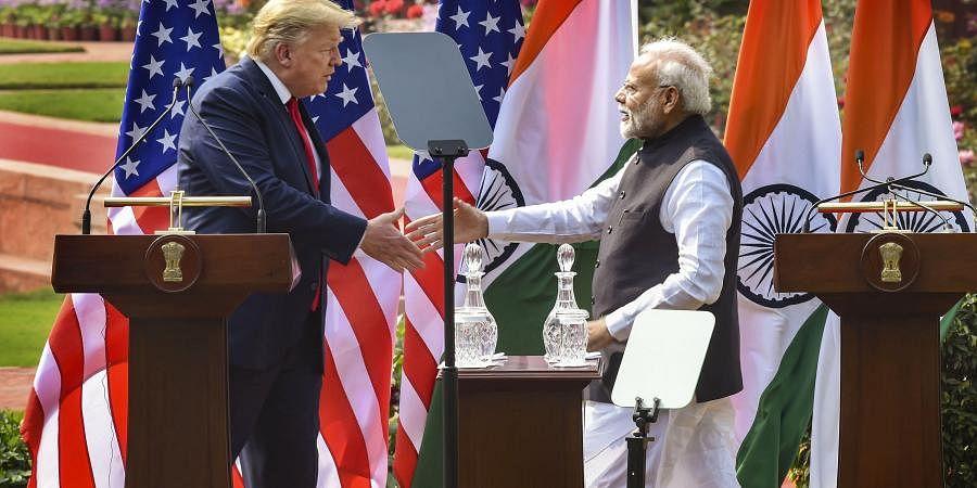 Prime Minister Narendra Modi (R) and US President Donald Trump. (File Photo | PTI)