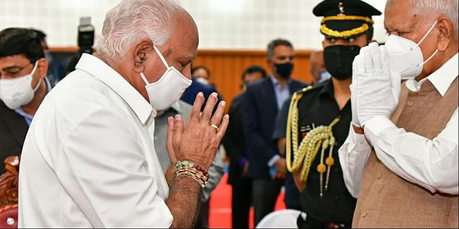 Governor Vajubhai Vala greets Chief Minister B S Yediyurappa during an event to mark the silver jubilee of the Rajiv Gandhi Institute of Health Sciences on Monday. Two special Postal Day covers, sponsored by RGUHS, were released on the occasion. One of the special covers commemorates the contribution of the university towards the fight against Covid-19, while the other marks the 25th Foundation Day of the university