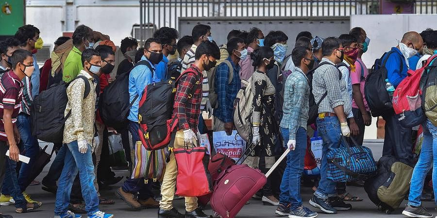Migrants step out of railway station after arriving via Shramik Special to reach their native places, during the ongoing COVID-19 nationwide lockdown