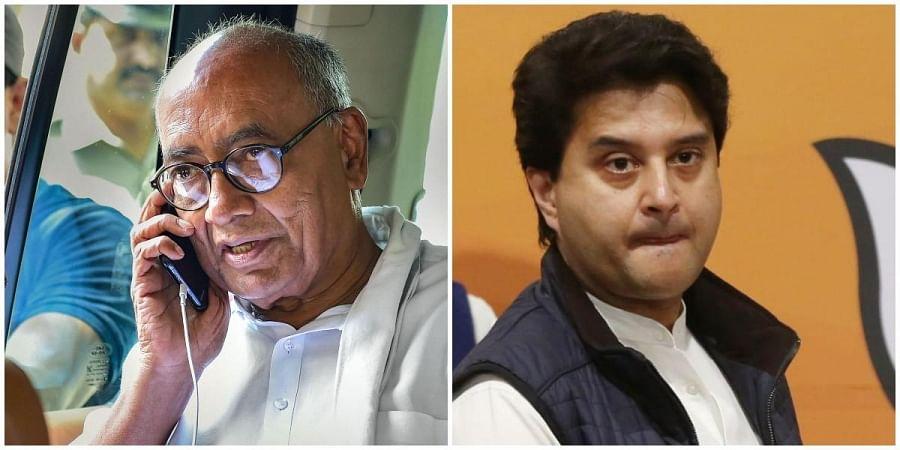 Senior Congress leader Digvijay Singh (L) and Congress-turned-BJP leader Jyotiraditya Scindia