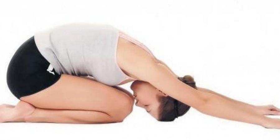 Balasana, or child's pose in Yoga.