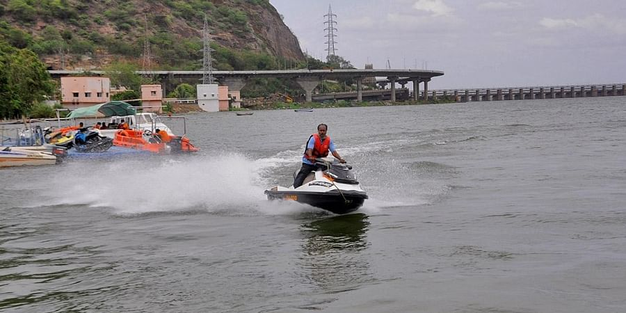 A boat operator taking a trial run of Jet Ski after the District Collector inaugurated Boating Command Control Room at Punnami Ghat in Vijayawada