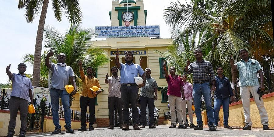 Golden Rock Railway workshop team that repaired the clocktower in District Court. The team is standing in front of century old clock tower in Golden Rock workshop in Tiruchy on Friday