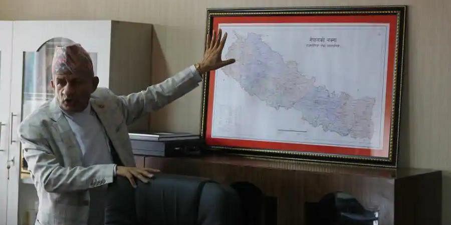 Nepal Foreign Minister Pradeep Gyawali points to a map of Nepal in Kathmandu.