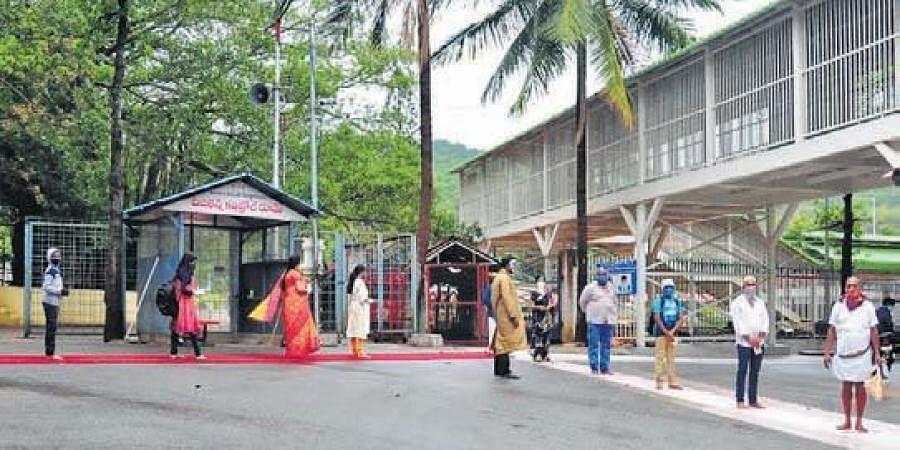 Wearing masks and maintaining social distancing, devotees seen lining up  at Tirumala temple for darshan.