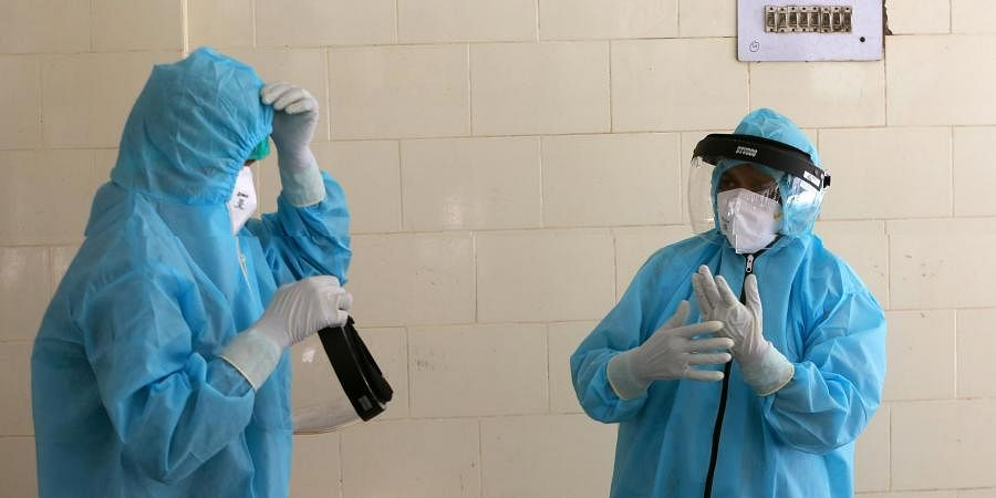 Health workers wearing PPE kit at a Covid-19 testing center in New Delhi