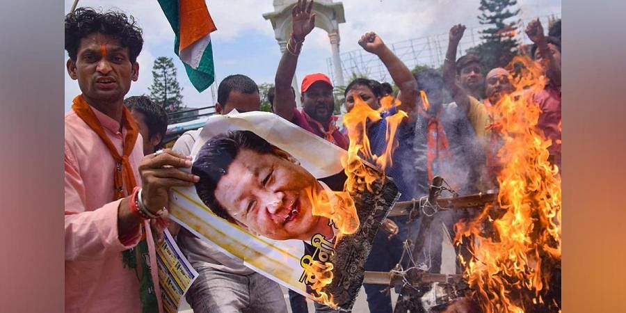 BJP activists burn an effigy of Chinese President Xi Jinping during a protest against the killing of 20 Indian Army soldiers in Ladakh's Galwan Valley by the Chinese troops, in Patna