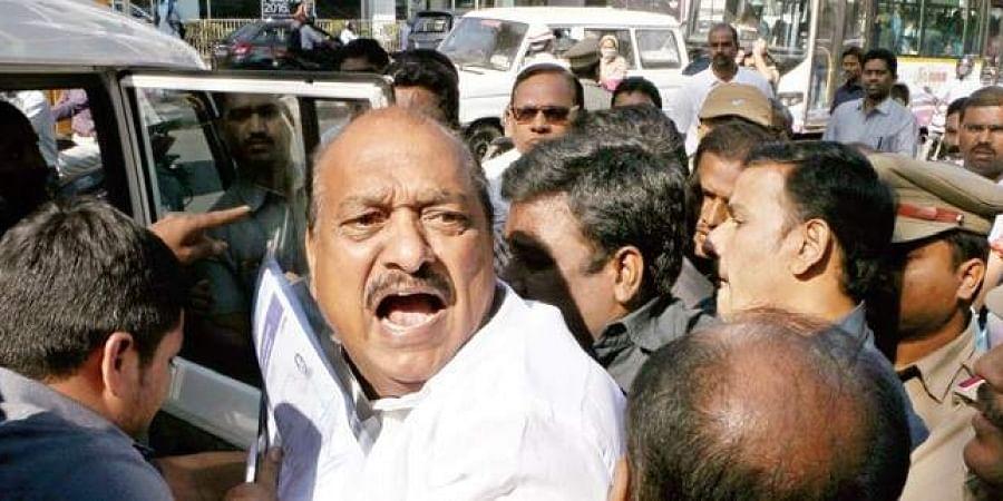 Tadipatri TDP legislator JC Prabhakar Reddy being arrested by the police at RTA office in Hyderabad.
