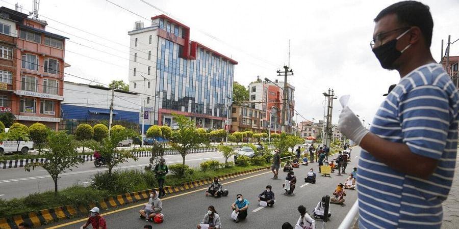 Protestors gather to demand better handling of the COVID-19 pandemic in Kathmandu, Nepal, Saturday, June 13, 2020.
