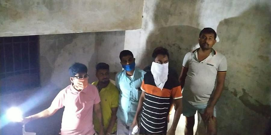 The SDM, tehsildar and others inspecting the quarantine centre at midnight.