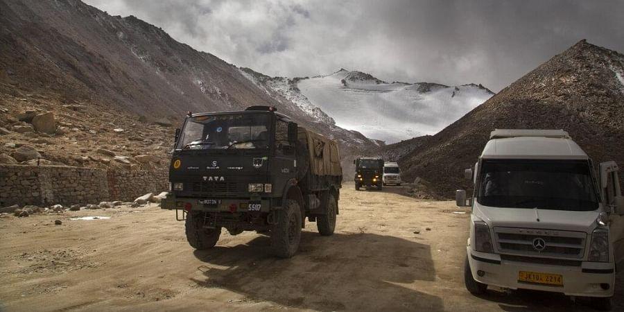 (File) Indian Army truck crosses Chang la pass near Pangong Lake in Ladakh region, (Photo   AP)
