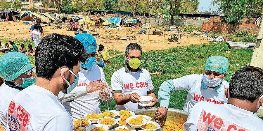 We Care volunteers distributing food.