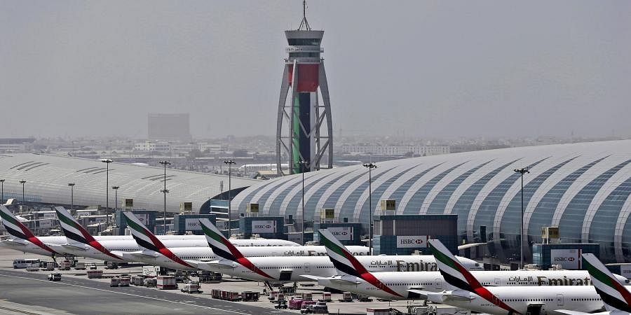 Emirates planes are parked at the Dubai International Airport