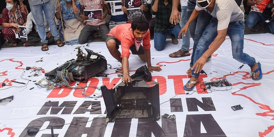Youth Congress activists smash Chinese products on a banner that reads 'Boycott Made In China' during a protest over the killing of 20 Indian Army soldiers in Ladakh's Galwan Valley by the Chinese People's Liberation Army PLA troops in Kolkata.