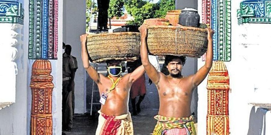 Servitors carrying Adapa Abhada from Gundicha temple on Thursday.
