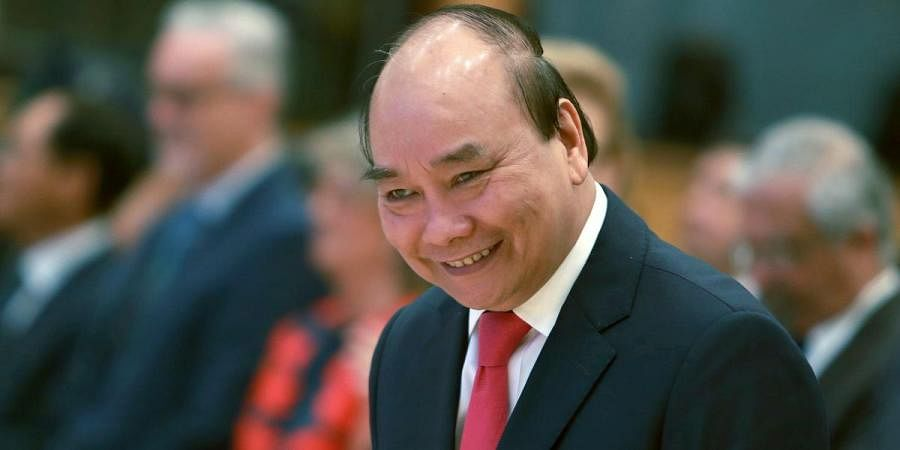 Vietnamese Prime Minister Nguyen Xuan Phuc arrives at the opening ceremony of the 36th ASEAN Summit in Hanoi