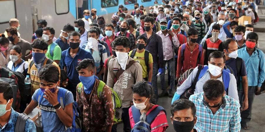 Migrants, who were stranded in Bhubaneswar, arrive at Howrah station during the nationwide lockdown amid COVID-19 pandemic