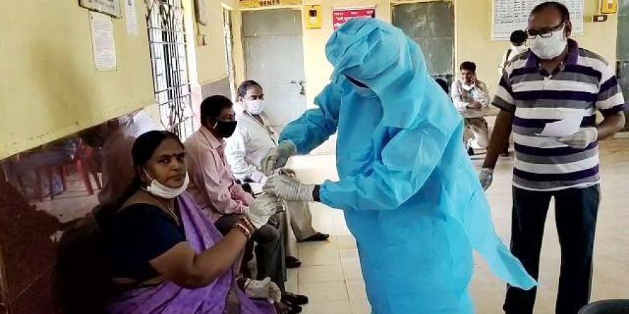 Medical team collecting samples from train passengers at Ichchapuram railway station Srikakulam.