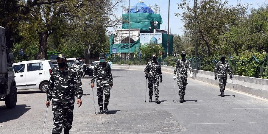CRPF pesonnel petrolling at the area near Nizamuddin mosque after people who attended the religious congregation at Tabligh-e-Jamaat's Markaz tested postive for COVID-19 in New Delhi