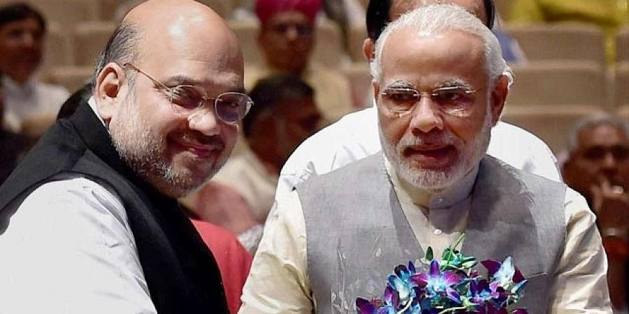 PM Narendra Modi (R) with Union Home Minister Amit Shah