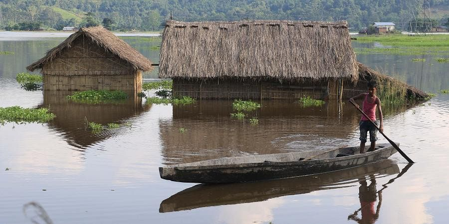 The floodwater breached river embankments and damaged bridges and roads.