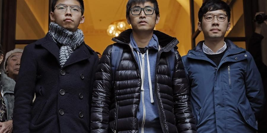 Pro-democracy activists Joshua Wong, Alex Chow and Nathan Law