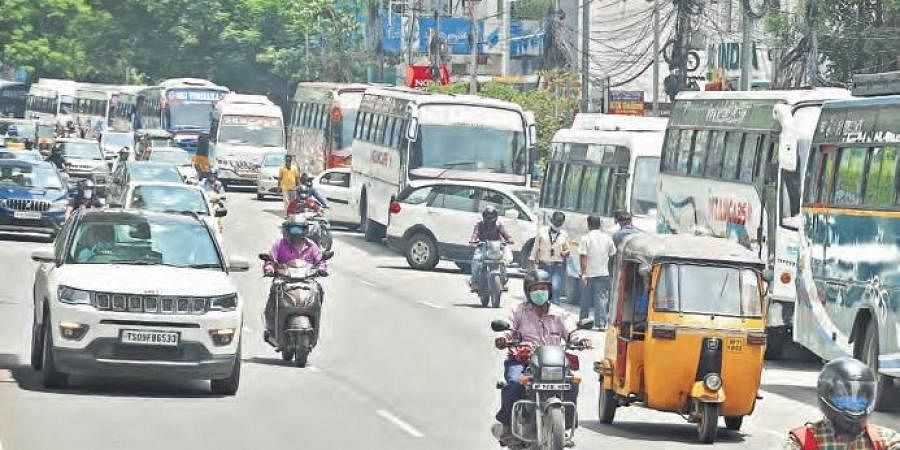 Operators of cabs and buses protested opposite the RTA office in Khairatabad by parking their vehicles, to demand waiver of MV tax for one quarter (Photo | R V K Rao, EPS)
