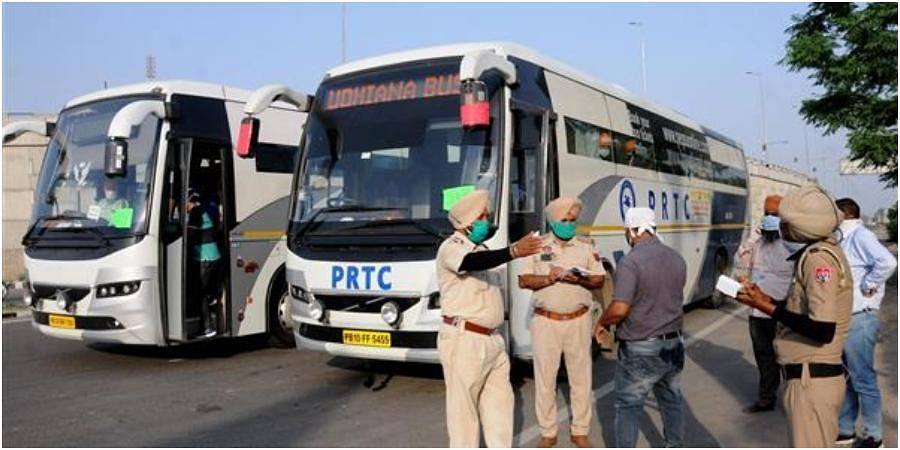 Punjab police checking details of passengers travelling in a bus.