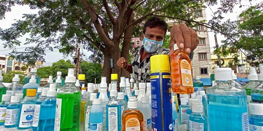 Durga Rao, who used to sell fancy items, now offers sanitisers at his makeshift shop near Vijayawada bus stand
