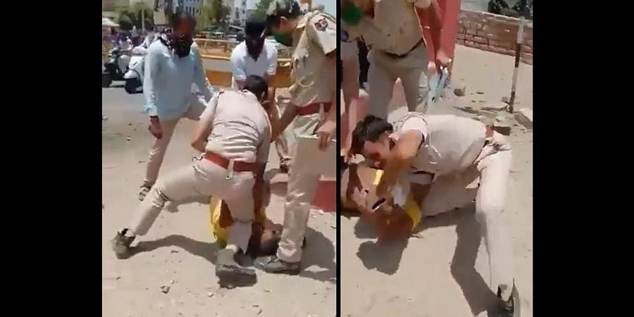Jodhpur cops press man's kneck with knees for not wearing mask