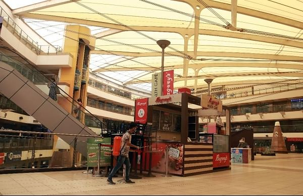 Man sanitizes a Delhi mall ahead of reopening on June 8 as allowed under Unlock 1. (Photo| EPS/ Shekhar Yadav)
