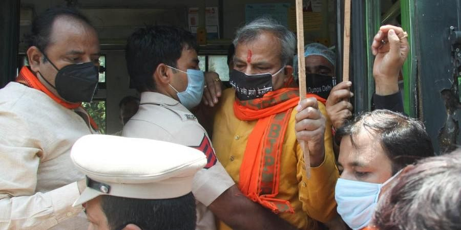 Delhi BJP chief Adesh Guptabeing detained by police at Rajghat during his protest against Kejriwal government for weakening health services