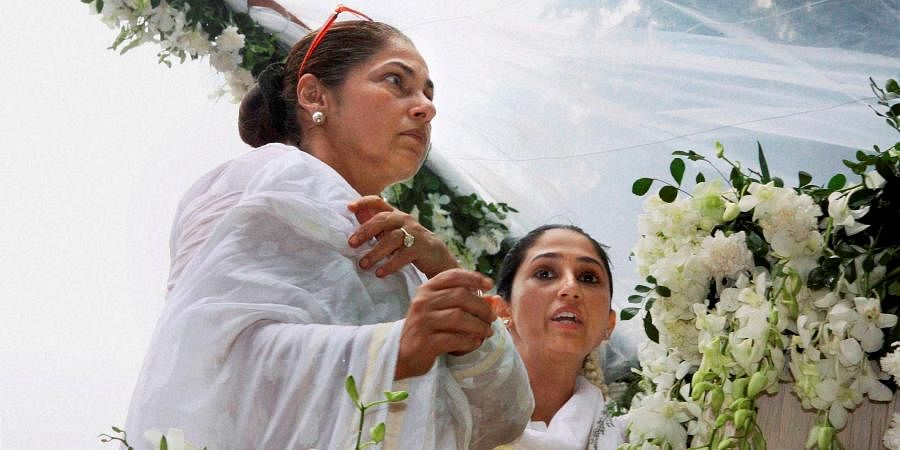 Bollywood actress Dimple Kapadia and Rinki Khanna during the funeral procession of the legendary actor Rajesh Khanna in Mumbai.