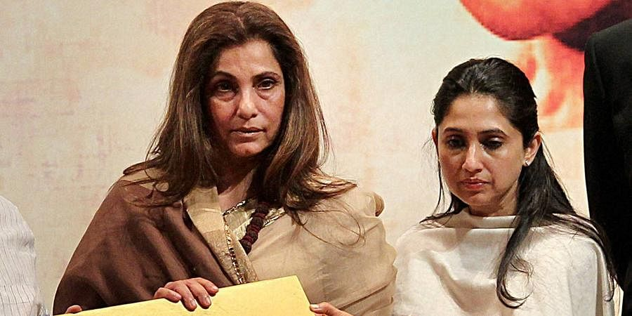 Bollywood actress Dimple Kapadia with her daughter Rinke Khanna releasing a CD during the inauguration of a three-day retrospective of Bollywood's first superstar Rajesh Khanna in New Delhi.