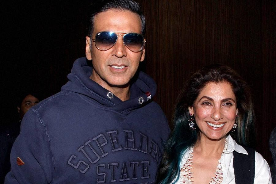Bollywood actor Akshay Kumar with his mother-in-law Dimple Kapadia attend the music launch of Marathi film 'Kaul Manacha'.