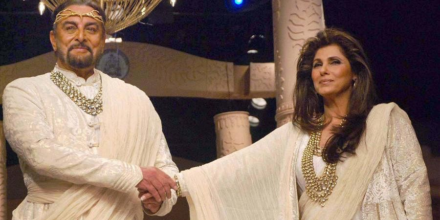 Bollywood actors Kabir Bedi and Dimple Kapadia on the ramp during designer show at Wills India Fashion Week in New Delhi.