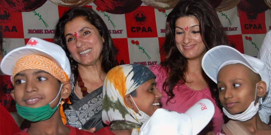 Bollywood actress Dimple Kapadia (L) along with her daughter Twinkle Khanna (R) seen with cancer patients on the occasion of National Cancer Rose Day in Mumbai.