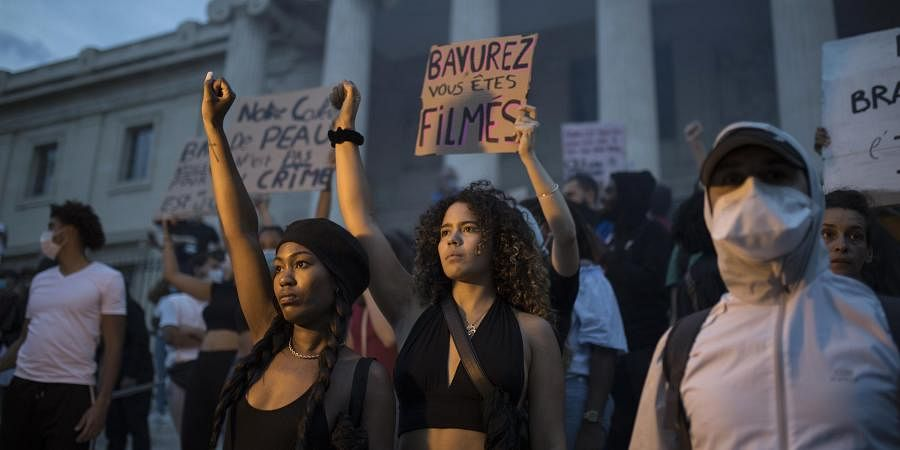 Protesters raise their fists in Marseille, southern France to protest against the recent death of George Floyd. (Photo| AP)
