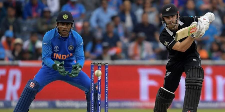 New Zealand's captain Kane Williamson (R) plays a shot as India's wicketkeeper Mahendra Singh Dhoni looks on during the 2019 Cricket World Cup first semi-final. (Photo | AFP)