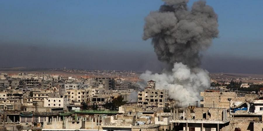 A smoke plume billows following a reported Syrian government air strike on a residential district of Maaret al-Numan in the northwestern Idlib province on December 18, 2019.