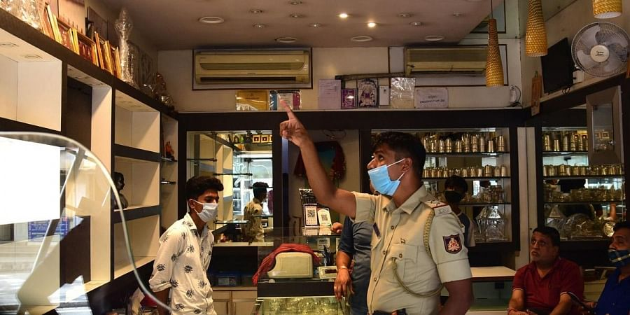 A police officer on Monday inspects Chirag Jewellers in Kumara Park East after the burglary