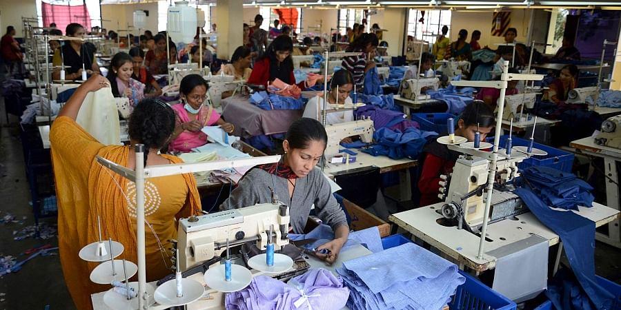 Garment workers at a unit in Peenya Industrial Estate, Bengaluru