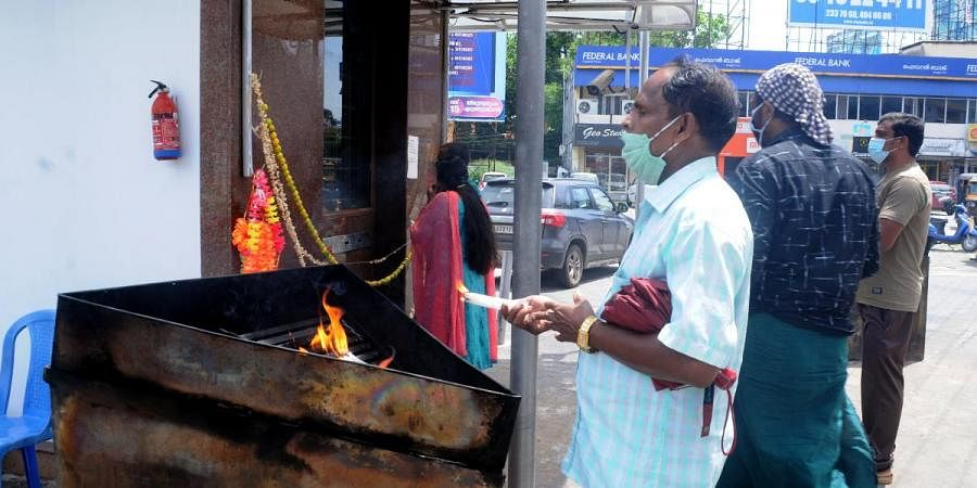 Devotees make do with praying at the small shrine in front of St Antony's Church in Kaloor
