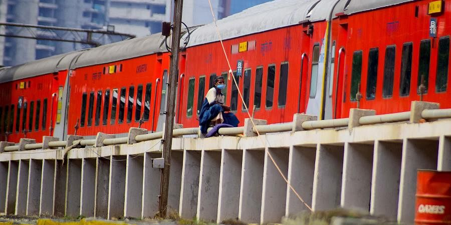 A labourer seen at the KSR Railway station in Bengaluru.