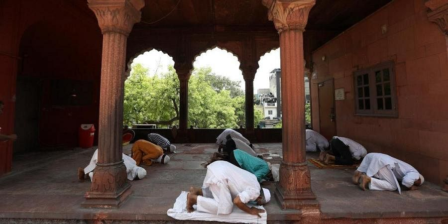 Muslims offer prayers after the Jama Masjid opened after 75 days of lockdown in Delhi
