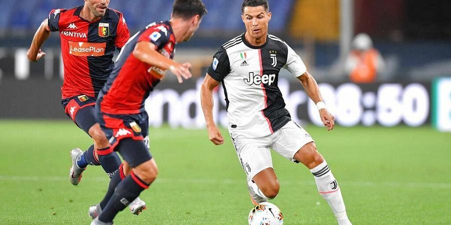 Juventus' Cristiano Ronaldo, right, runs with the ball during the Italian Serie A soccer match between Genoa and Juventus at the Luigi Ferraris stadium in Genoa, Italy. (Photo |AP)