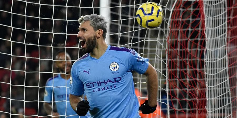 Manchester City's Sergio Aguero celebrates after scoring his side's opening goal during the English Premier League soccer match between Sheffield United and Manchester City at Bramall Lane in Sheffield.