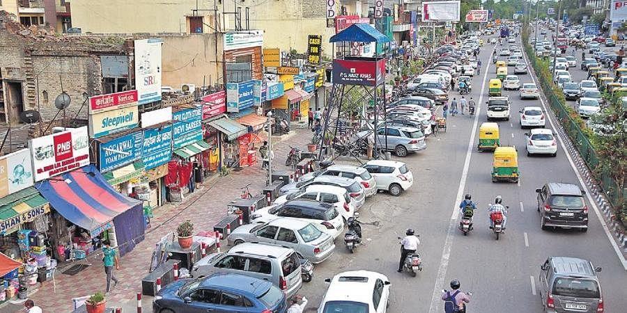Cars parked at Yusuf Sarai market in New Delhi.
